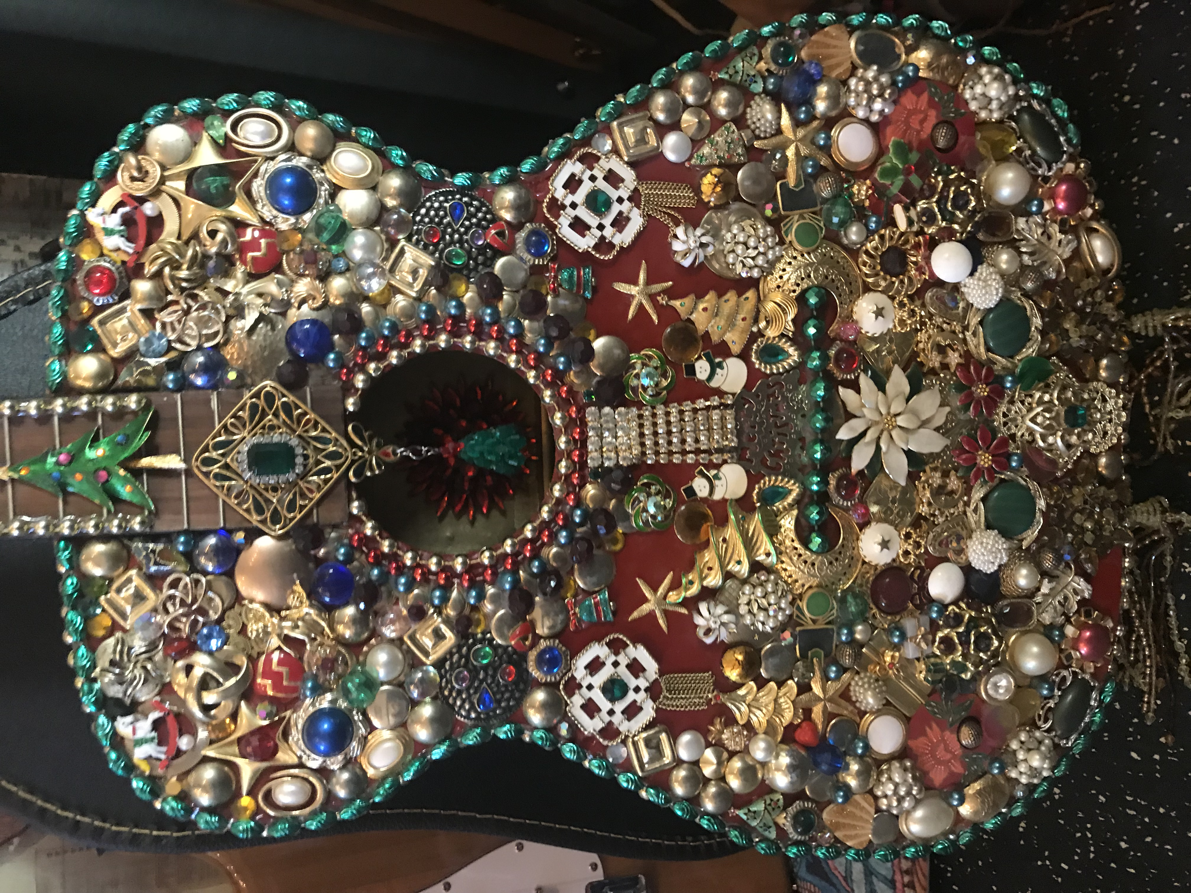 Decorated guitars by artisan Gloria Woods from North Kingstown, RI